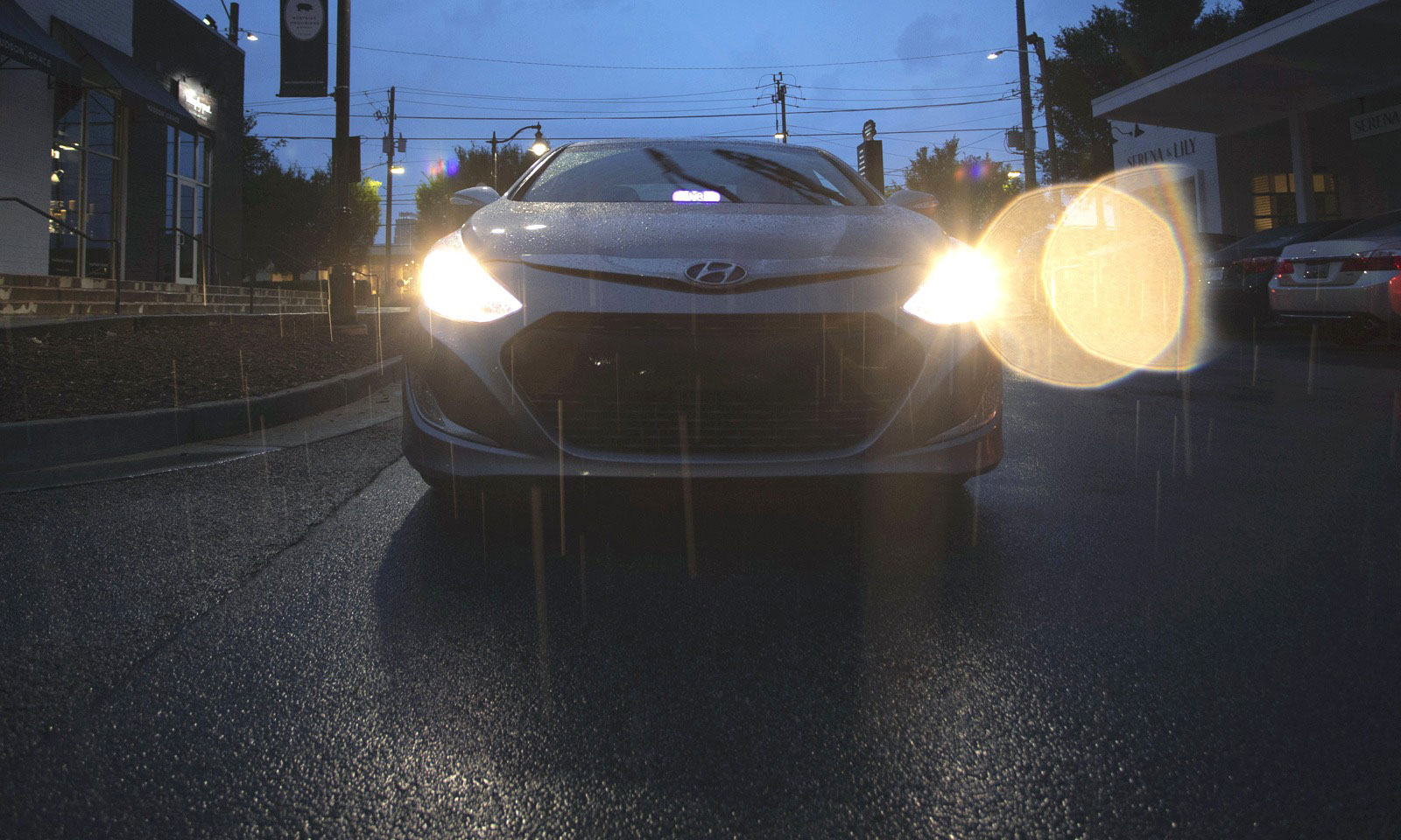 Car front with lights turned on