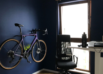 Bike on a wall next to desk