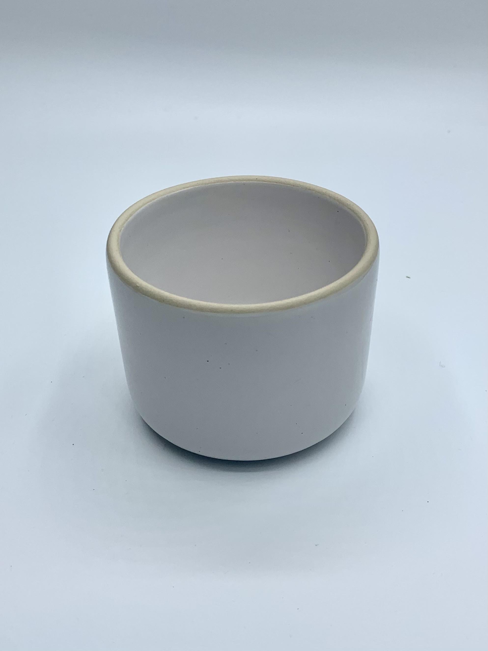 white ceramic small pot