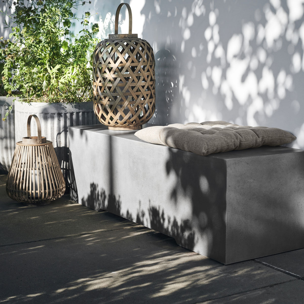 grey concrete garden bench