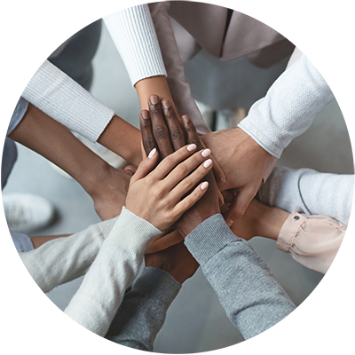 Image of Multi-Ethnic Hands touching in the middle of a circle representing Diversity & Inclusion
