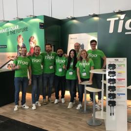 Tigo Energy team members at a conference