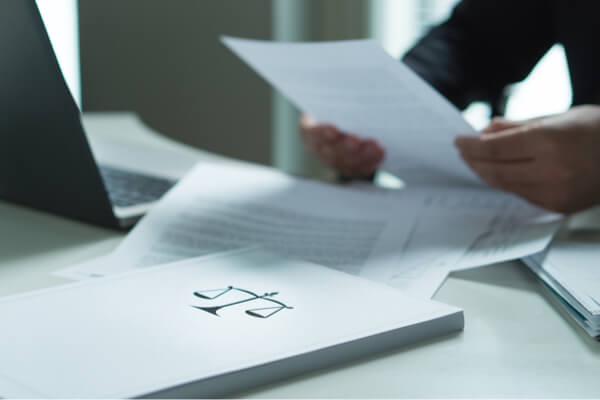 man reading paper on business legal issues