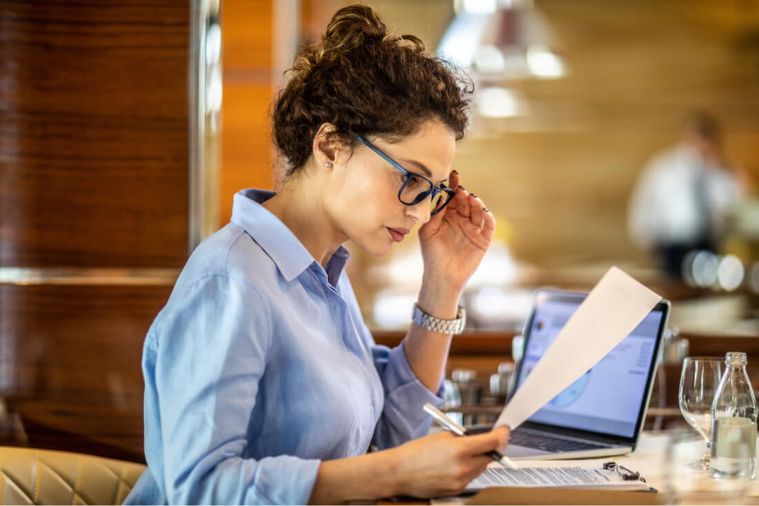 Woman working and reading paper GAAP