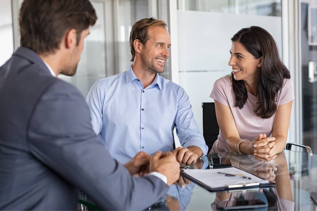 Man and woman smiling business planning stage