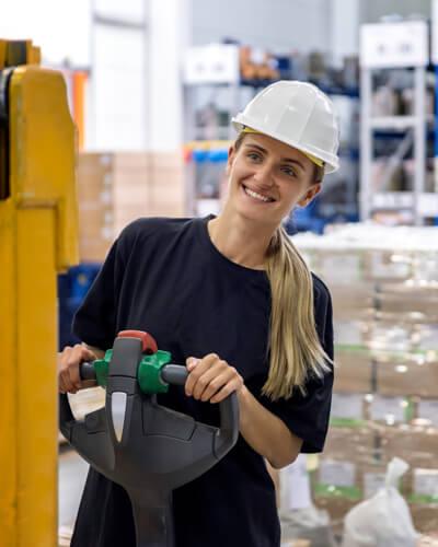 Woman driving pallets distribution