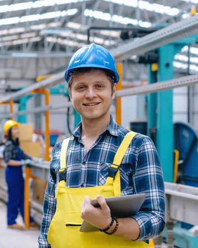Manufacturer holding tablet