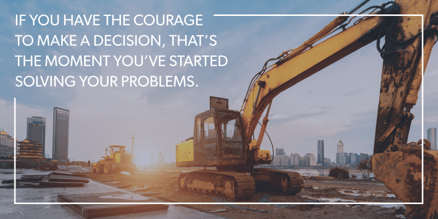"An image of a bulldozer with ""If you have the courage to make a decision, that's the moment you've started solving your problems"" overlying the image."