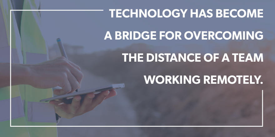 "A man in a reflective vest writing on a tablet with the quote ""technology has become a bridger for overcoming the distance of a team working remotely."""