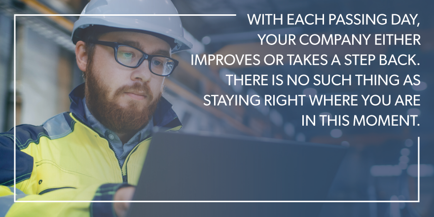 """A man on his computer with text stating """"with each passing day, your company either improves or takes a step back. there is no such thing as staying right where you are in this moment."""" over the image."""