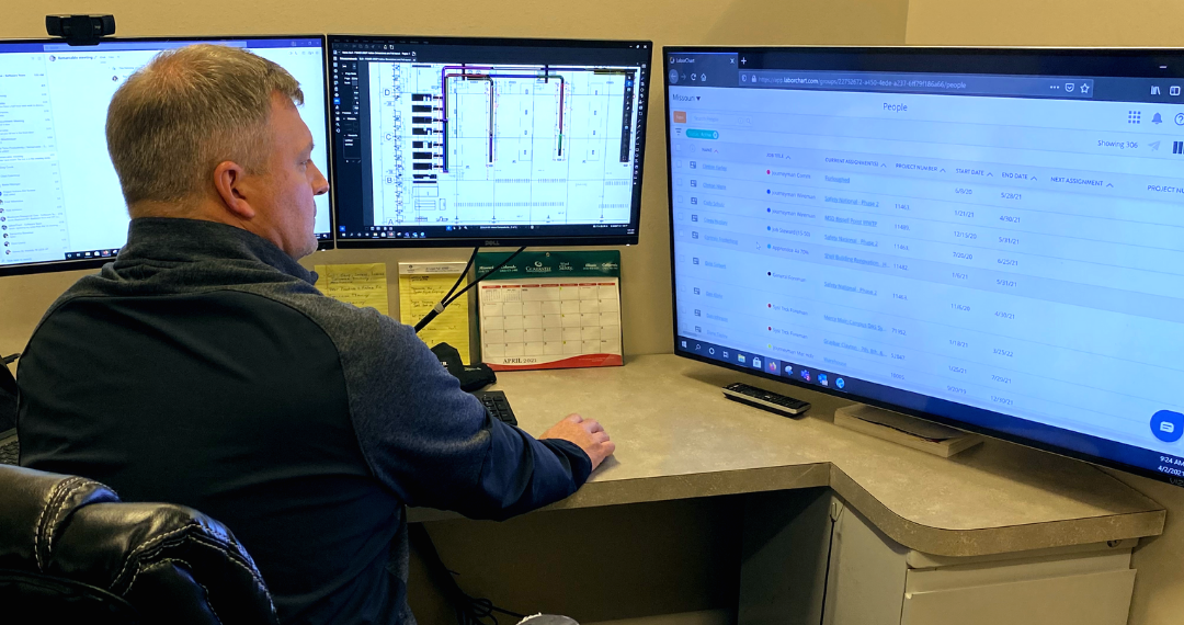 A LaborChart admin from Guarantee Electric managing his construction workforce on his computer.