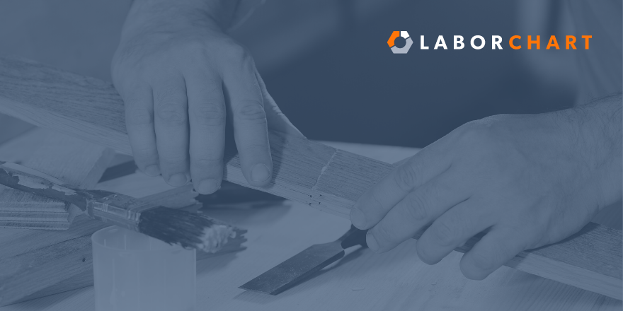 A picture of hands gluing a piece of wood together with the LaborChart logo in the upper right hand corner.