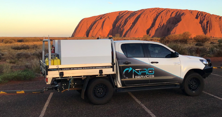 A NRG Services electrical contracting van in front of Australia mountains.