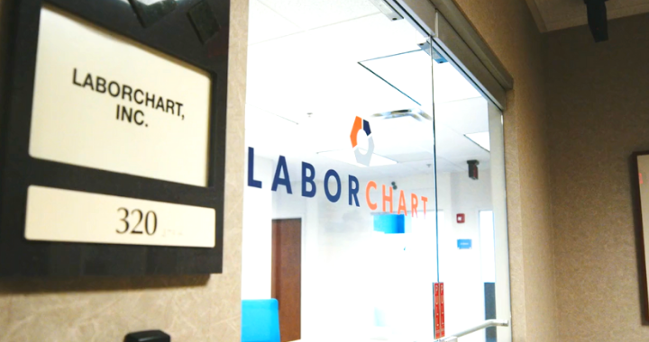 An image of the LaborChart logo on the door at the LaborChart overland park office.