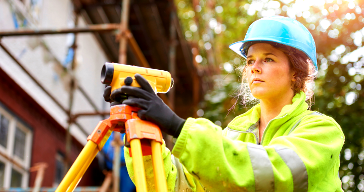 A woman construction field engineer with a futuristic look in her eye.