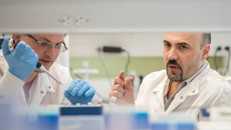 Dr. Coba and a team member in his lab.