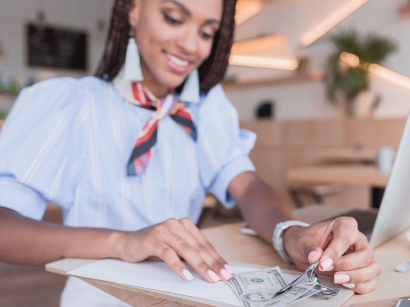 Young African-American women paying with cash.