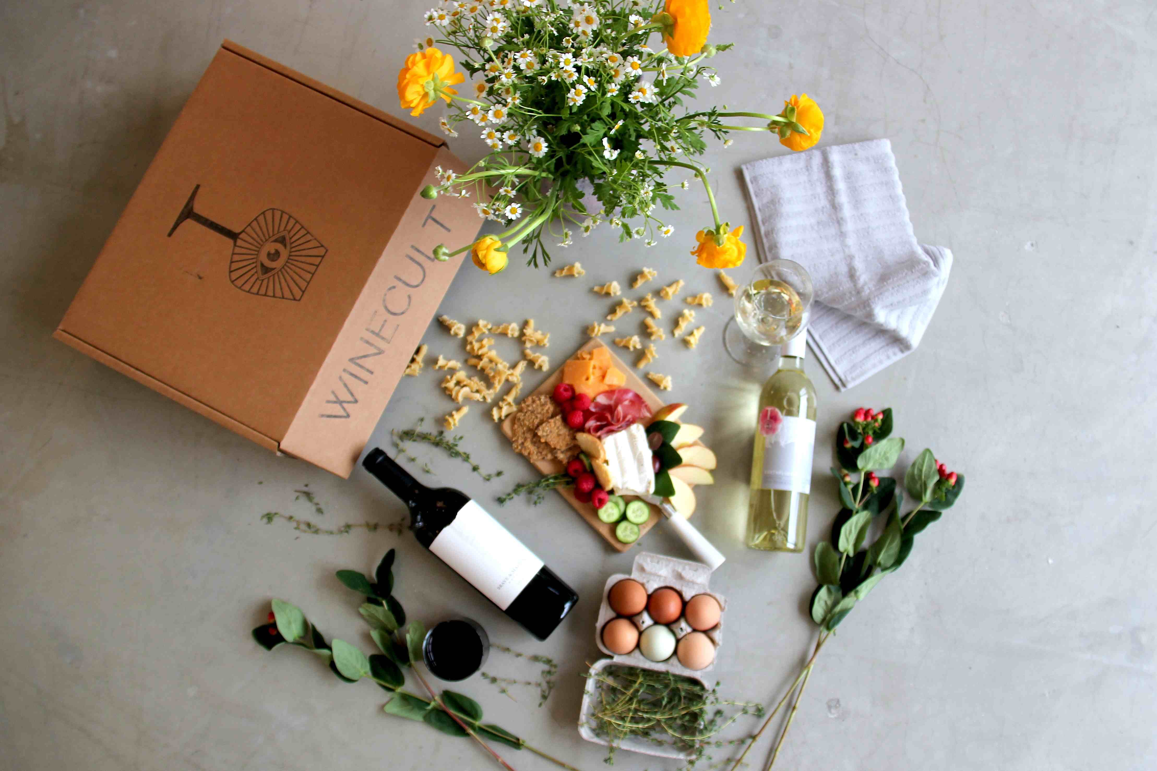 WINECULT club box with flowers, cheese board, wine, and picnic supplies