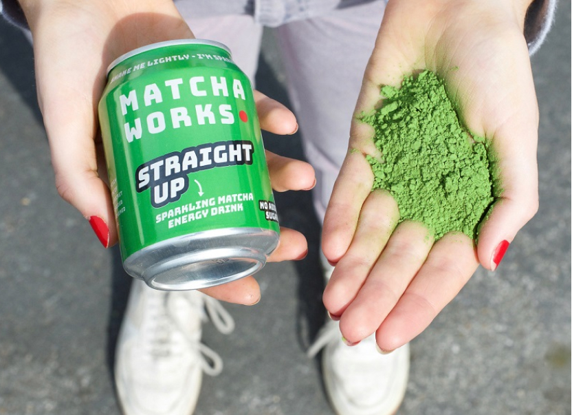 A pair of hands holding a can of Matcha Works green tea and a handful of green tea powder. Matcha Works was the previous company started by the co-founders of Blueprint.