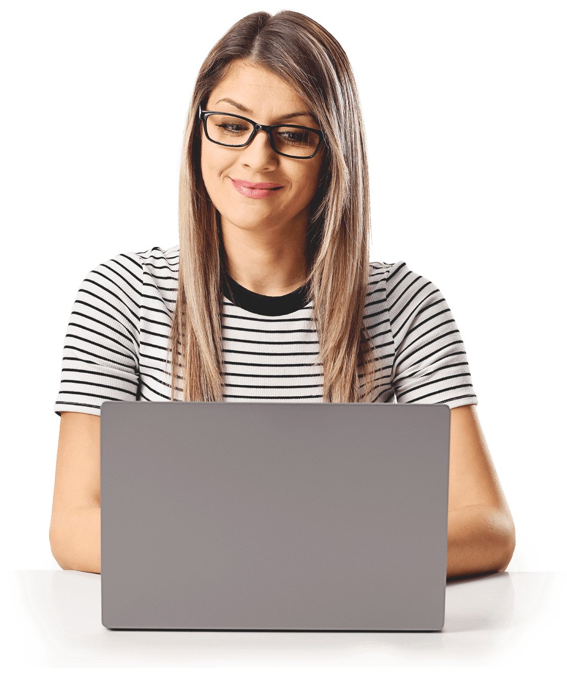A young woman in glasses and a striped shirt with long blonde hair sitting in front of a laptop.