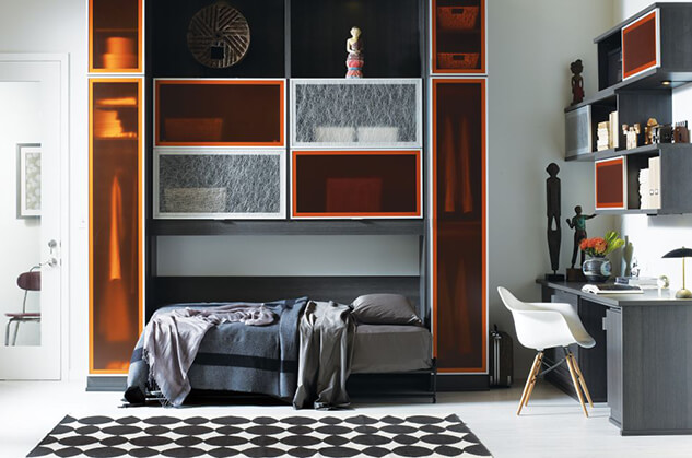 A grey and orange themed bedroom.