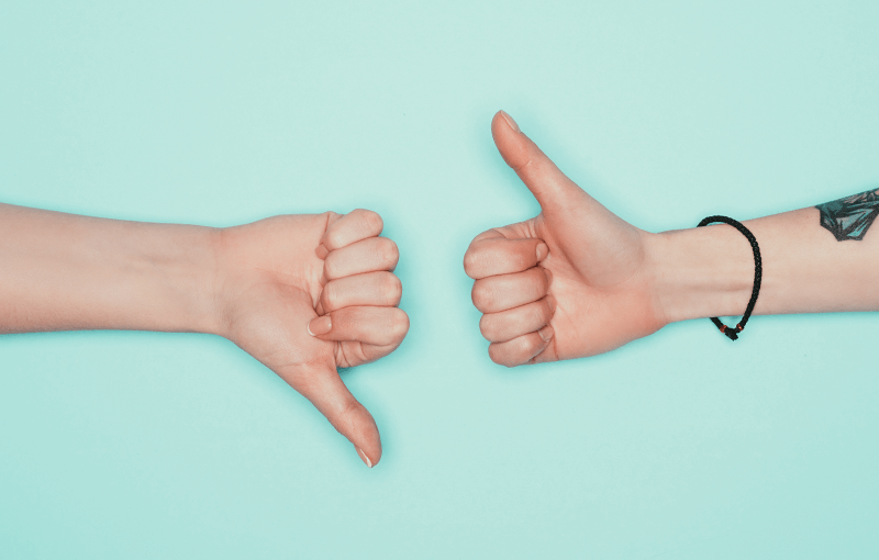 """Two hands on a blue background, one gives the """"thumbs up"""" and the other """"thumbs down"""" - Neovation Learning Solutions"""