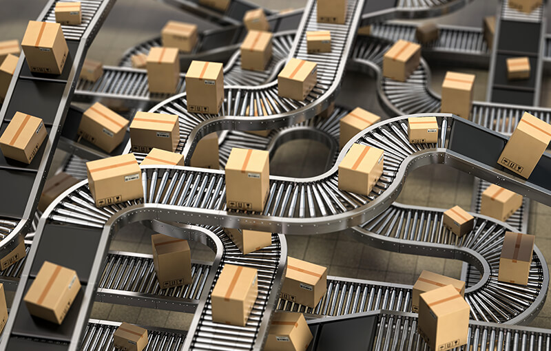 Many cardboard box packages on winding conveyor belts and rollers.