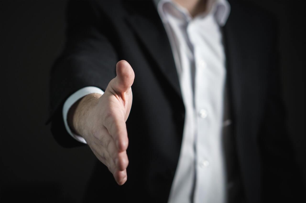 man offering hand for handshake