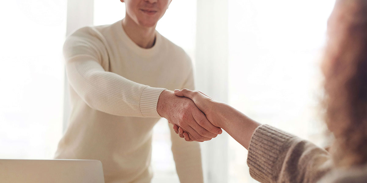 People shaking hands at job interview