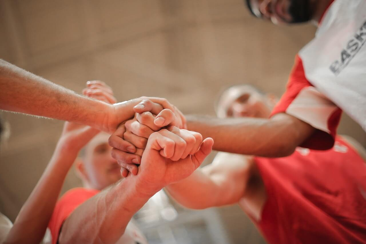 team joining hands