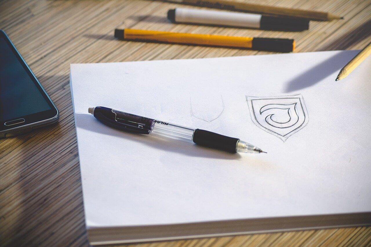 pencil sketch of a logo