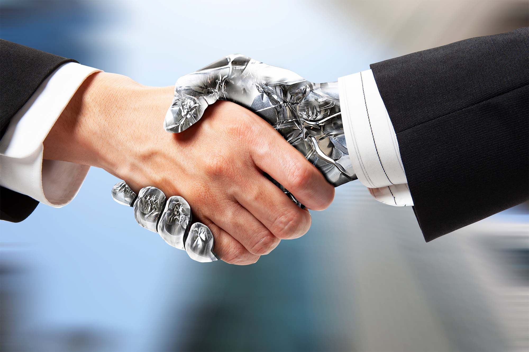 Human hand shaking robotic hand