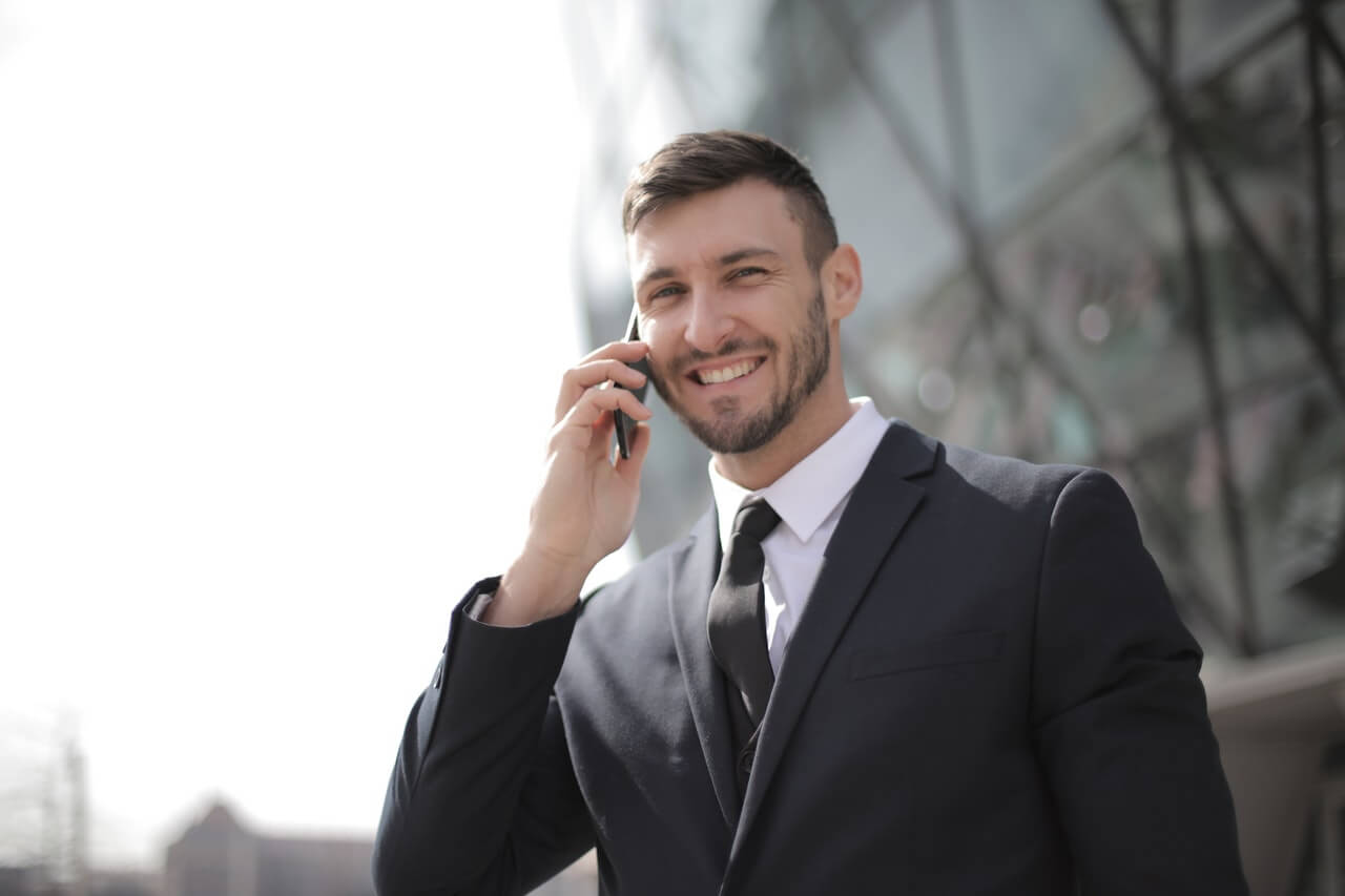 man talking on cell phone deal business