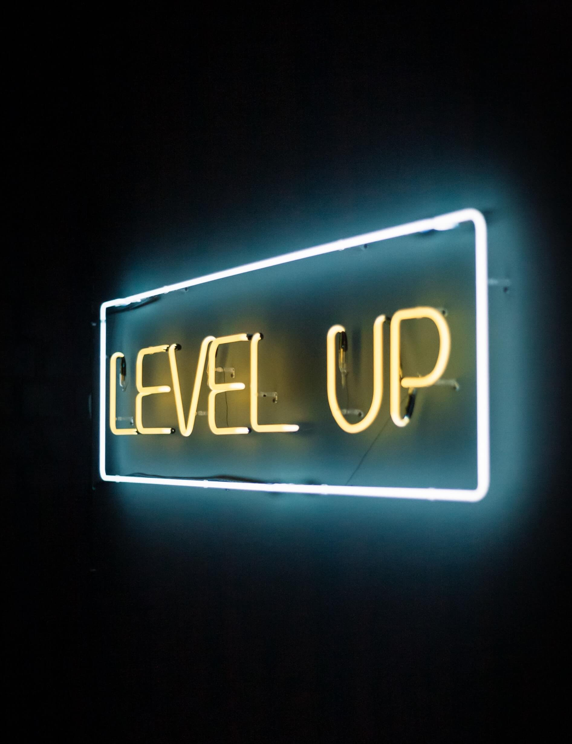 neon lights sign with phrase that reads level up