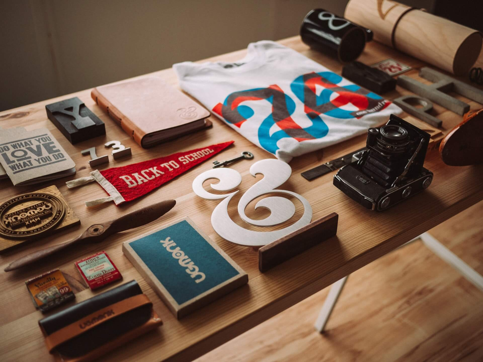 Table with branding elements like logos, t-shirt, and stamps