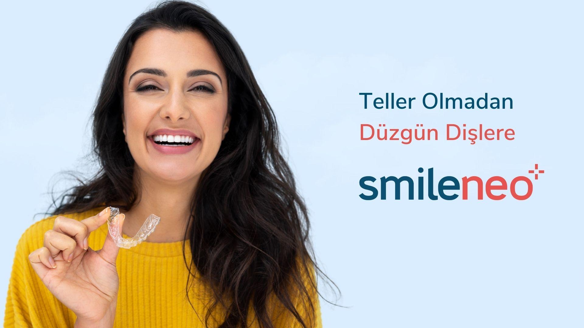 Smiling woman holding aligner