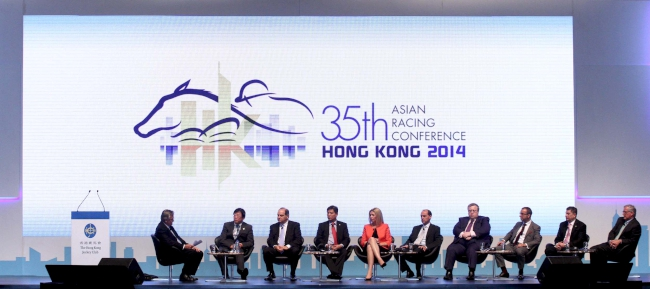 Several top racing executives from different countries are present on stage to discuss their experience and strategies in hosting world-class race events.