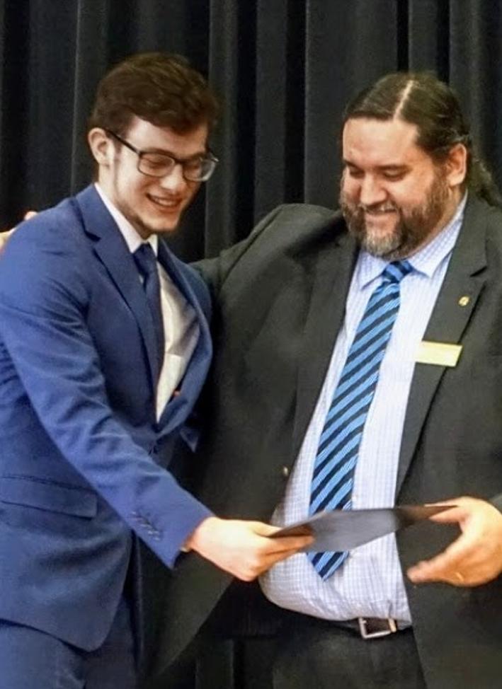 Matthew receiving a certificate