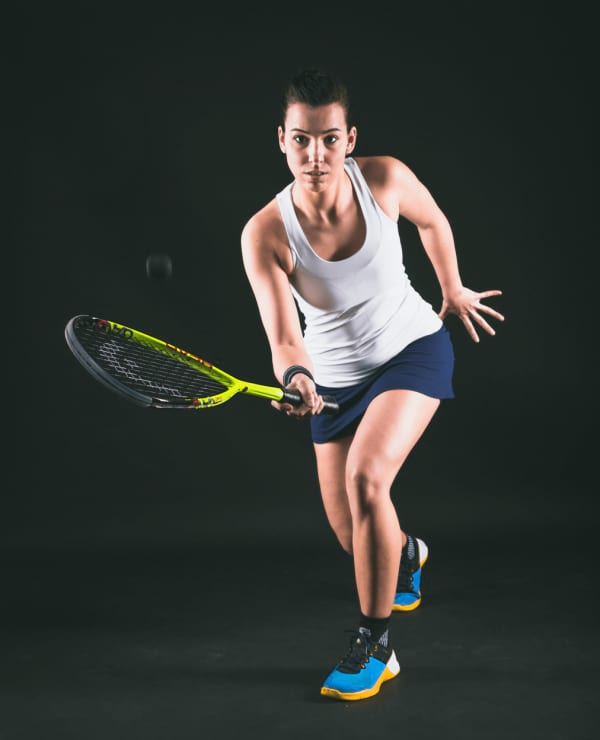 Female squash player holding a racquet