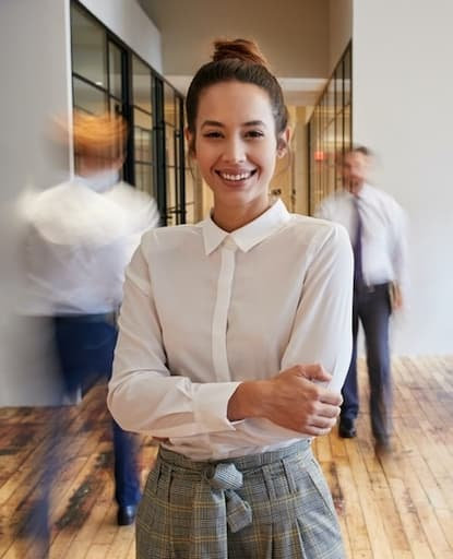 A business woman standing in a busy office