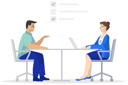 An illustration of a man and woman sitting at a table with laptops conversing.