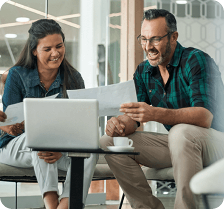 Two people gathered at a laptop