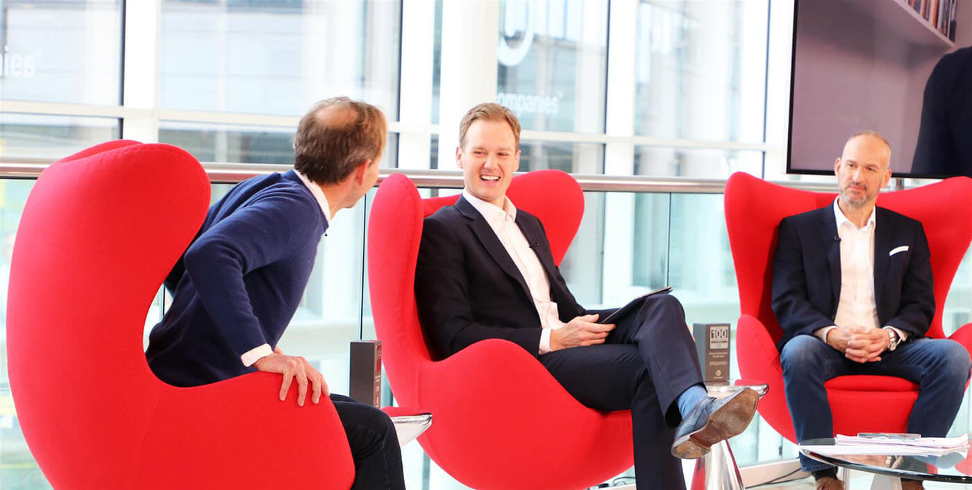 Two guests and presenter Dan Walker on the set of Best Companies Live