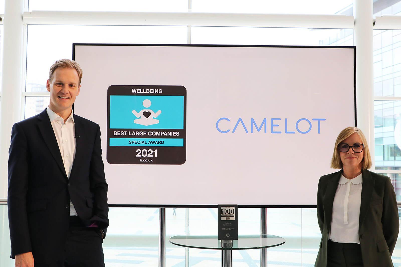 TV Presenter Dan Walker with Camelot UK Lotteries People Director Rachel King  receiving the Wellbeing Special Award at Best Companies Live