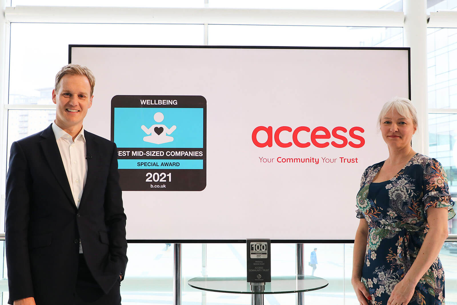 Access Community Trust CEO Emma Ratzer MBE receiving the Wellbeing Special Award from presenter Dan Walker at Best Companies Live