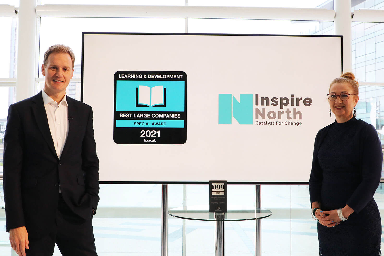 CEO of Inspire North Ruth Kettle and presenter Dan Walker with the Learning and Development Special Award at Best Companies Live
