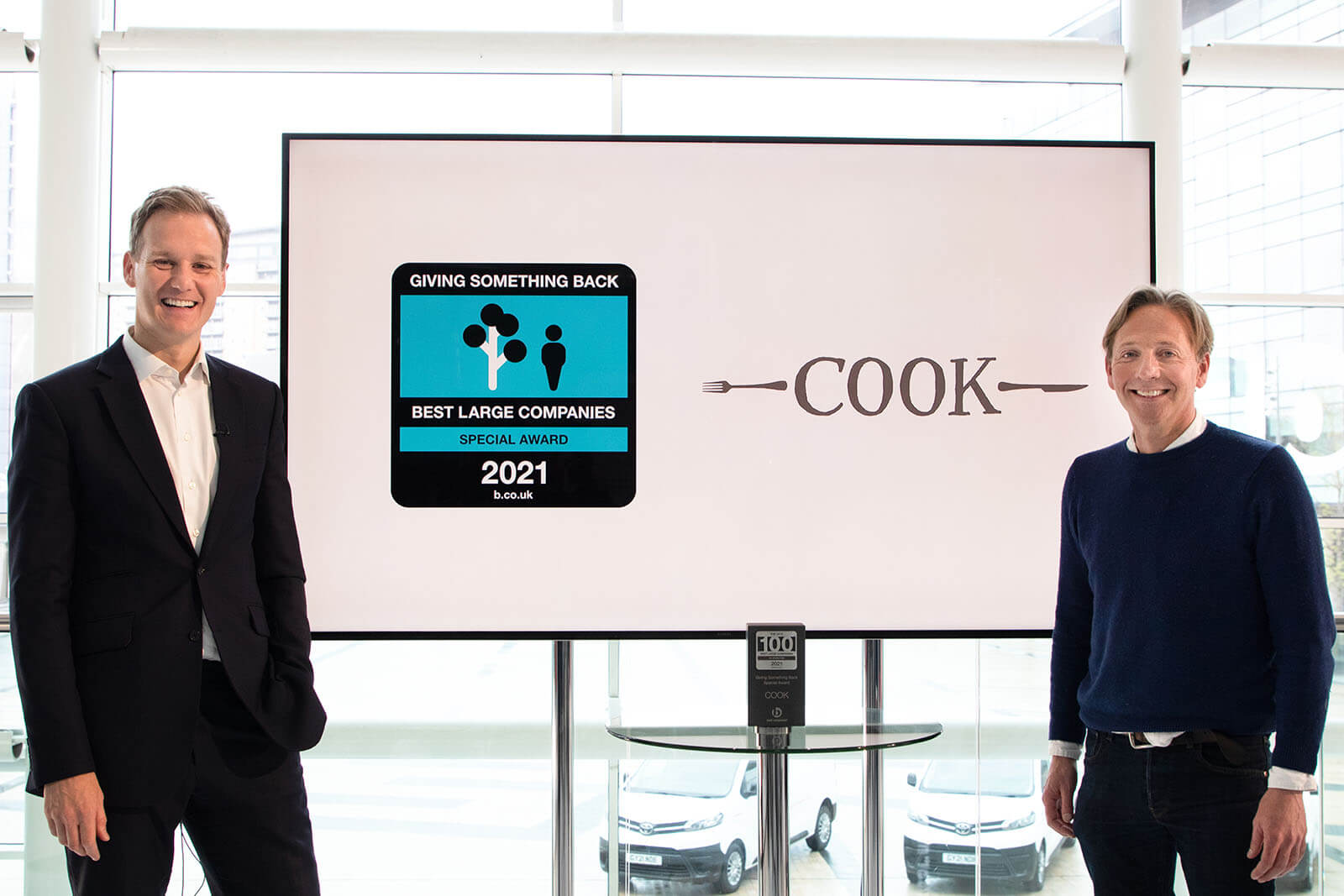 TV Presenter Dan Walker and CEO of Cook Trading Edward Perry with their Giving Something Back Special Award at Best Companies Live