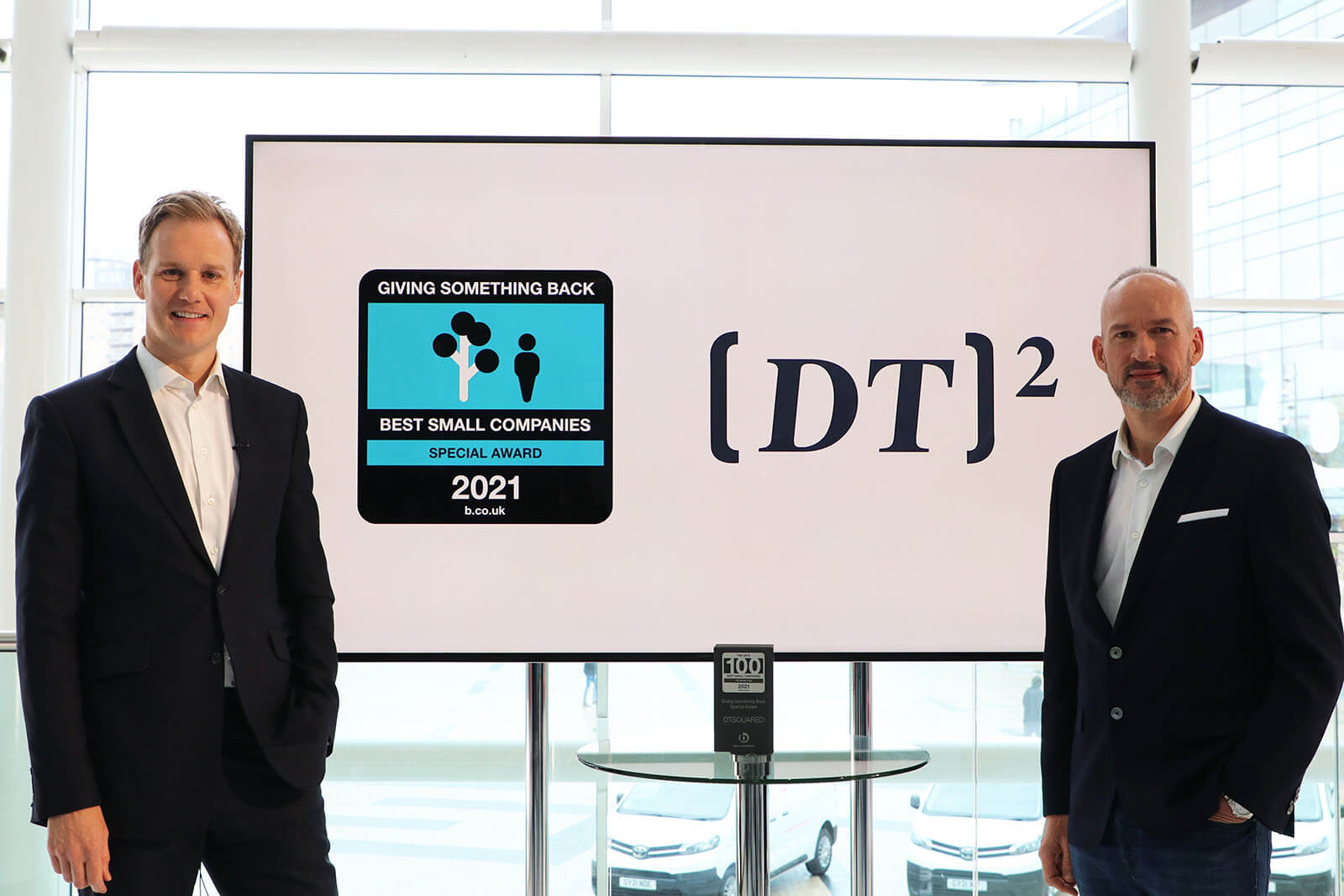 TV Presenter Dan Walker with Toby Pearson CEO Of DTSquared and their Giving Something Back Special Award at Best Companies Live