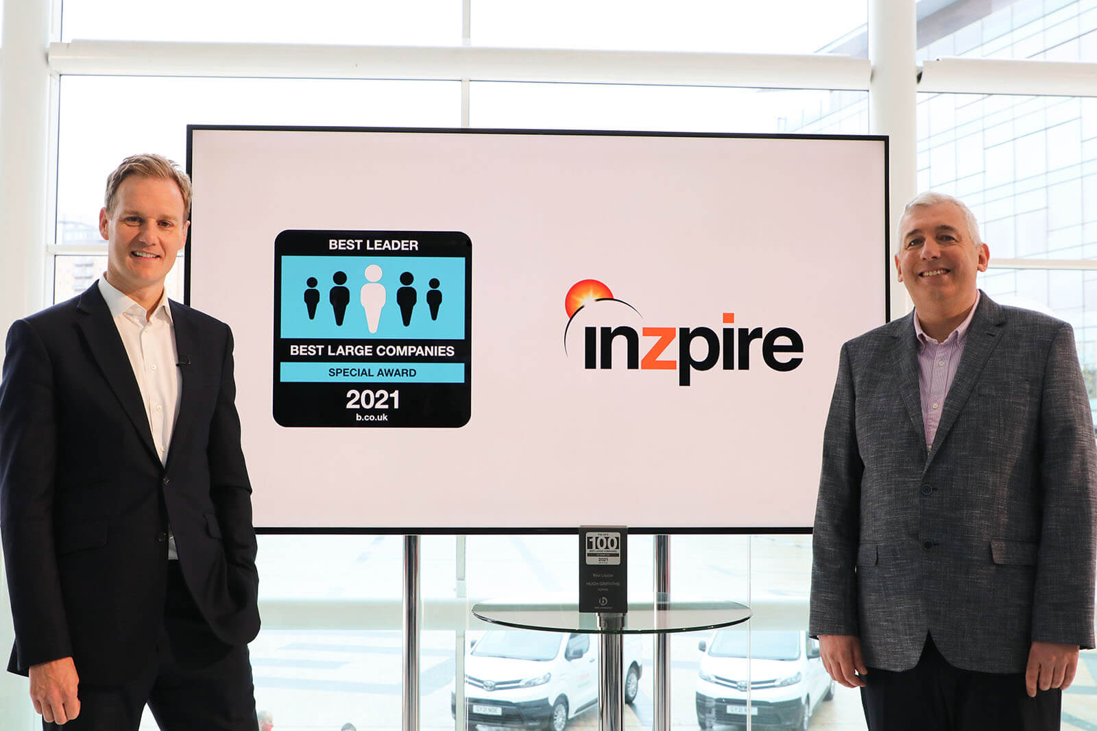 CEO of Inzpire Hugh Griffiths with Presenter Dank Walker and the Best Leader Special Award at Best Companies Live