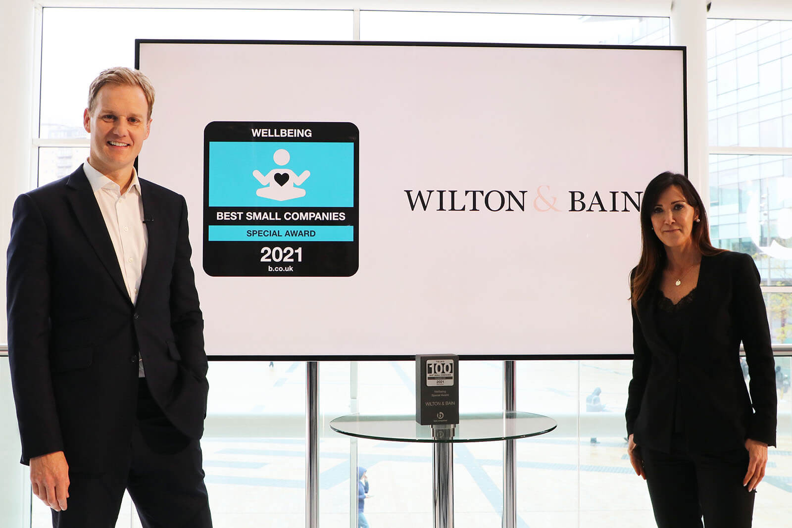 People and brand Director of Wilton and Bain Claire Elliott with presenter Dan Walker and the Wellbeing Special Award at Best Companies Live